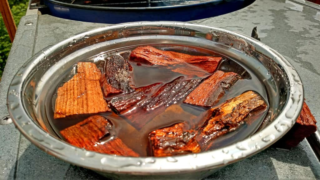 wood chunks soaking in a bowl of water