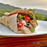 Easy Chicken Gyros warm pita bread stuffed with juicy chicken topped with tomatoes, cucumber, red onion, lettuce, black olives drizzled with Greek Dressing. | TheMountainKitchen.com