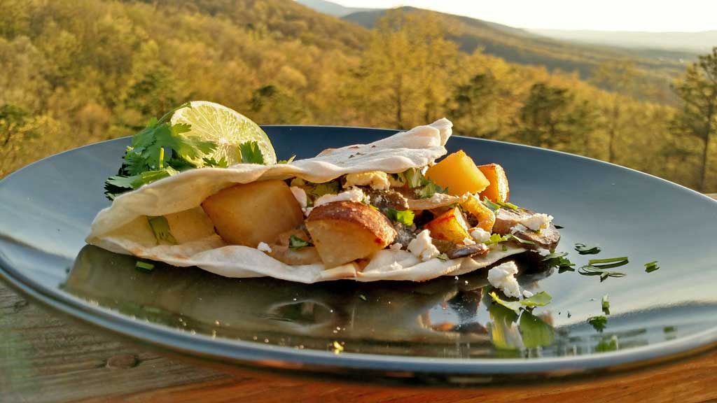 Tacos, filled with roasted poblano peppers, sauteed mushrooms and onions with country-style skillet potatoes served in a cream sauce with a hint of lime.   TheMountainKitchen.com