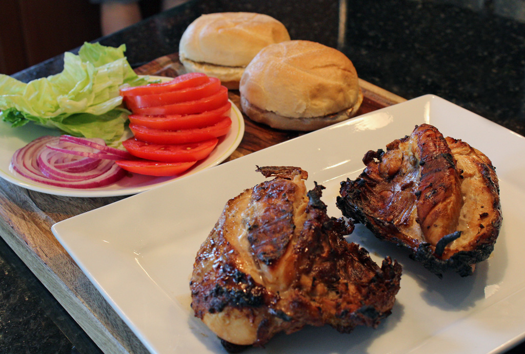 Grilled Teriyaki Chicken Sandwiches with perfectly grilled chicken breasts marinated in a teriyaki sauce made of soy sauce, fresh ginger, garlic and hints of toasted sesame oil on top of a toasted bun with lettuce, tomato and red onions. | TheMountainKitchen.com