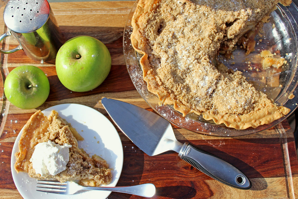 This is the best apple crumb pie ever! This pie is like taking a bite into fall, made with deliciously crisp fall mountain apples, baked coated with brown sugar, and warm spices like cinnamon, nutmeg and cloves. This pie is crowned with a buttery, brown sugar, and cinnamon crumb topping, making it an all-time favorite apple recipe. | TheMountainKitchen.com