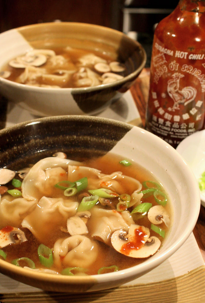 This wonton soup is made of dumplings filled with a mixture of seasoned ground pork, soy sauce, rice vinegar and ginger, gently simmered in ginger broth. | TheMountainKitchen.com