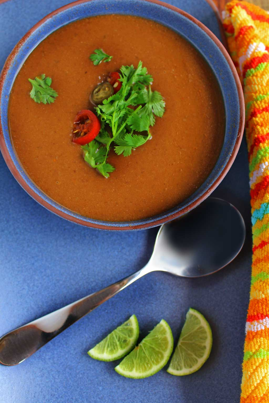 This healthy crock-pot black bean soup is packed with hearty plant-based protein, veggie, and spice and oh so easy to make, it practically makes itself. It's light on calories, high in fiber and easy on your wallet. A great recipe to try for Meatless Monday or any day of the week! | TheMountainKitchen.com