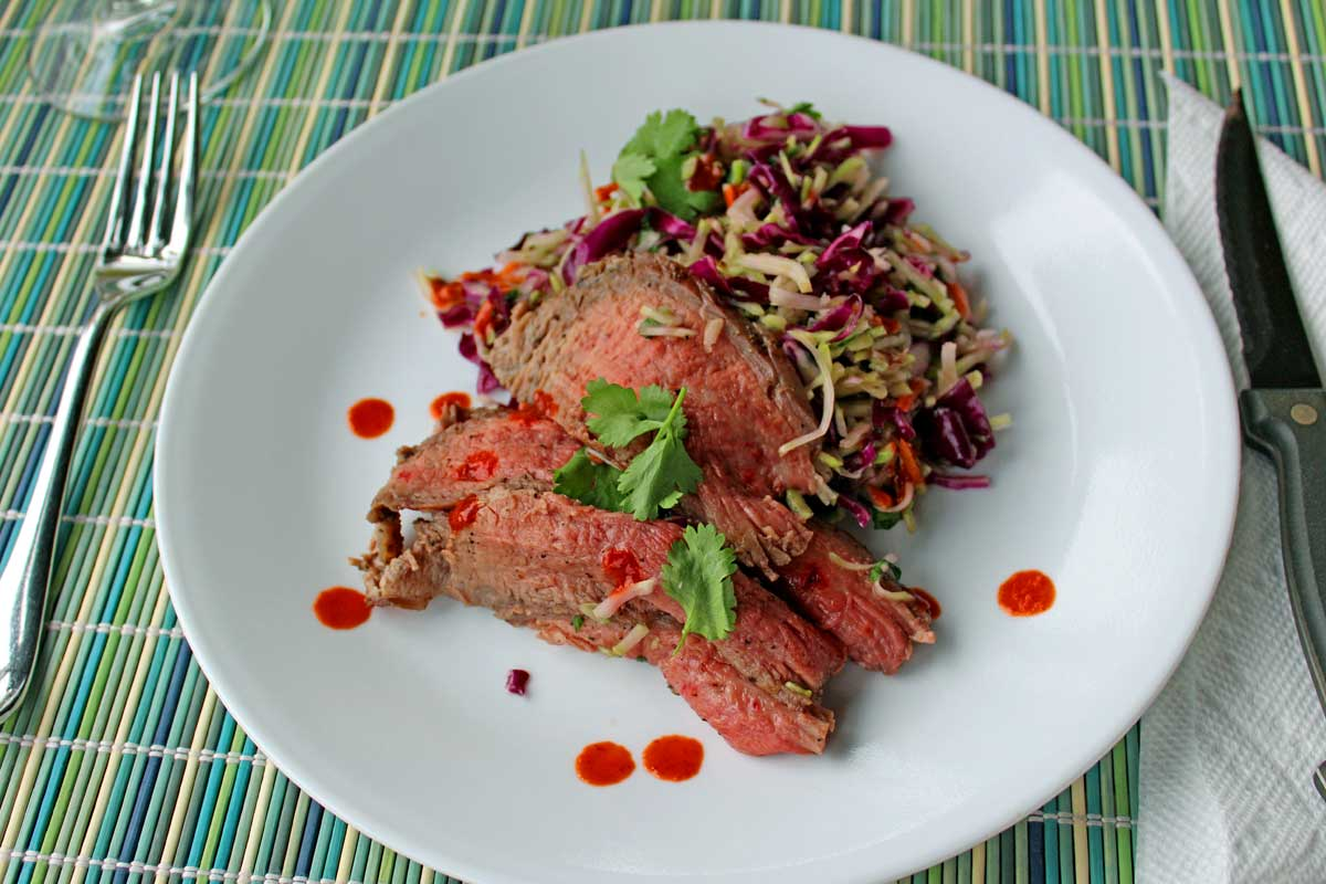 This is a quick and easy Grilled Thai Steak Salad is infused with such amazing Asian flavor. Crisp salad paired with grilled flank steak. Try it tonight!   TheMountainKitchen.com