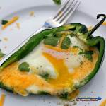 Egg stuffed poblano pepper boats are a low-carb twist to the classic egg in a basket. A great vegetarian option to serve for any Meatless Monday meal.