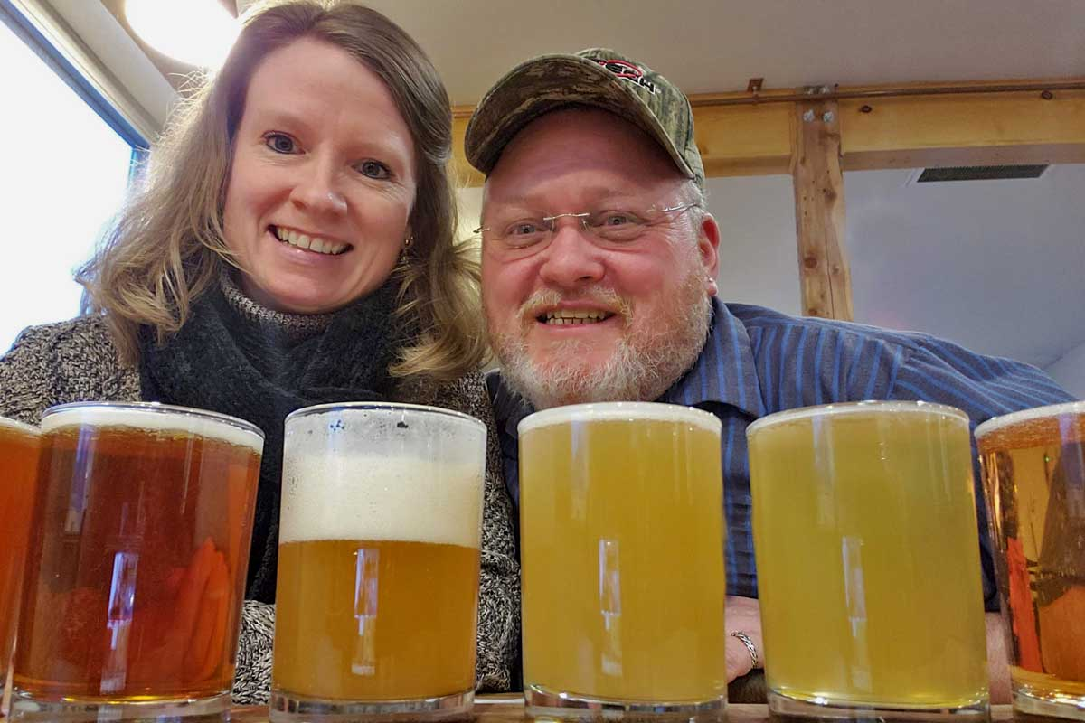 Debbie and David having a flight of beer