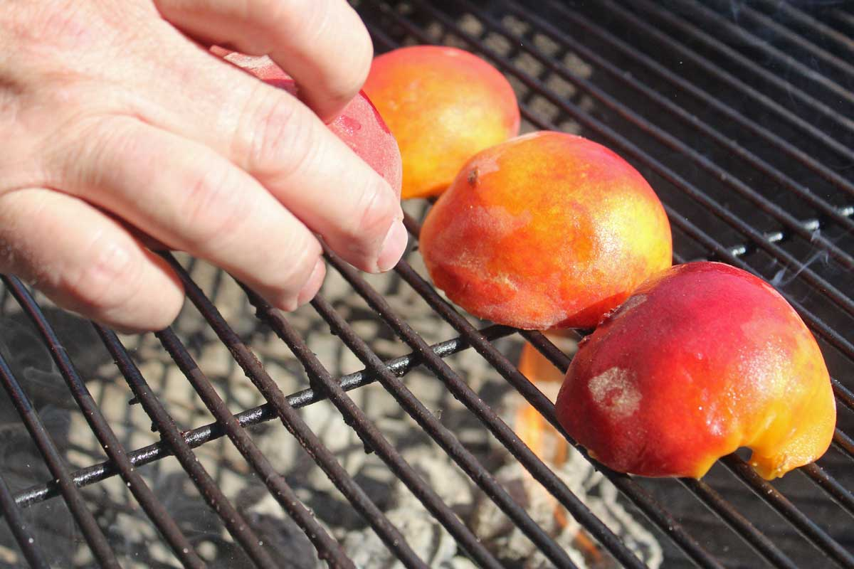 placing peaches on grill