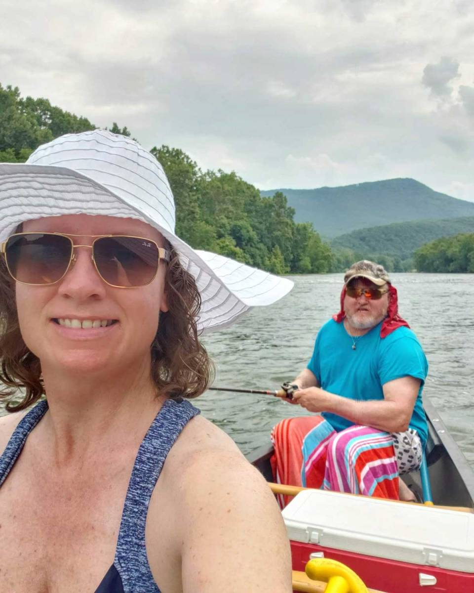 Debbie and David on canoe in river