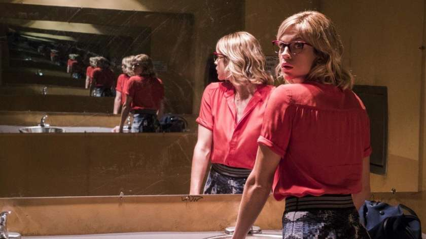 Parallel film, woman looks into mirror repeated into infinity