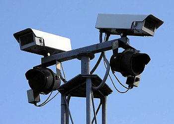English: Two fixed-view security cameras, and ...