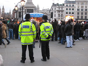 English: Metropolitan Police officers on patro...