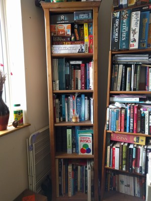 The thinnest upstairs bookshelf is the academic bookshelf, which has a lot of university textbooks on it