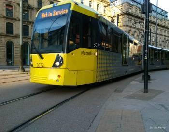 A yellow Manchester tram