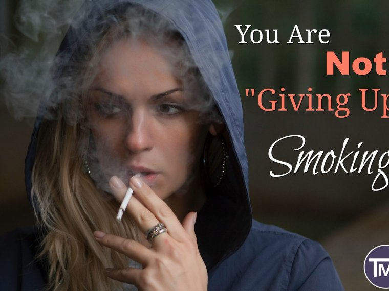 woman in blue hoodie holding cigarrette about to smoke it - You are not giving up smoking feature