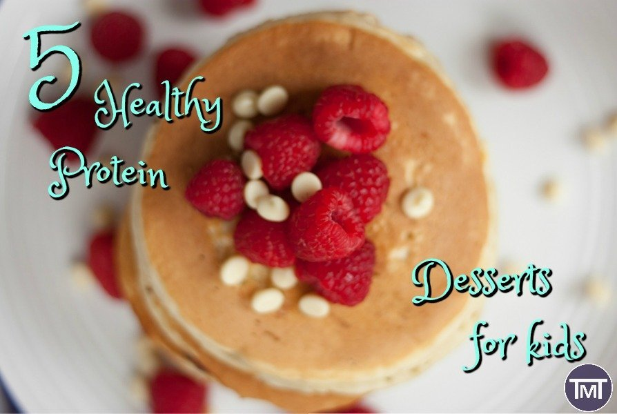 aerial view of stack of pancakes with raspberries on top with text overlay - 5 healthy protein desserts especially for kids , to make sure they are healthy, happy and getting proper nutrition. Guest Post by Adam