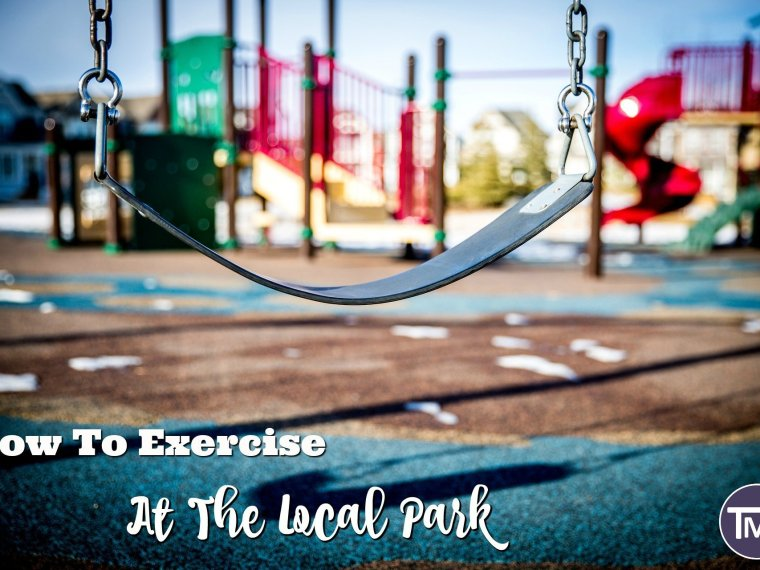 close up of swing with multicolored jungle gym in the background with text overlay - how to exercise at the local park feature