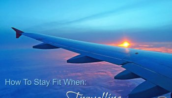 aeroplane wing in sky with sunset in the background with text overlay - How to stay fit when travelling feature image