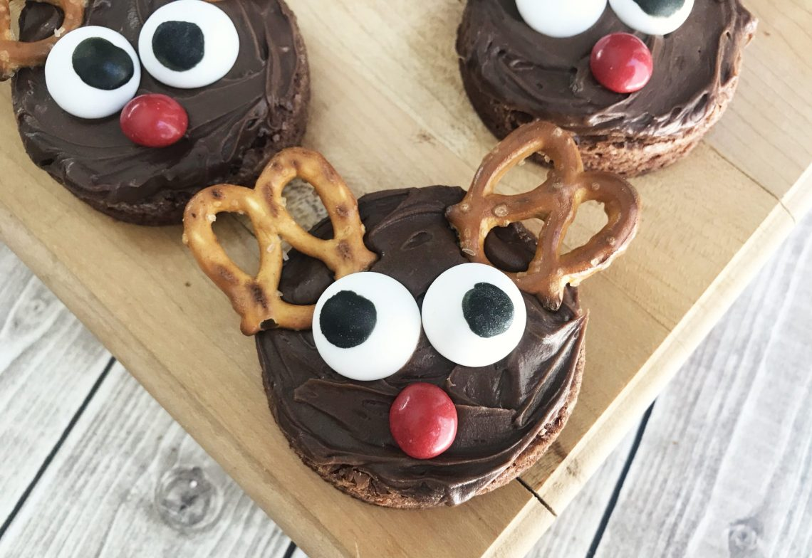 reindeer brownies on a chopping board with background - feature image