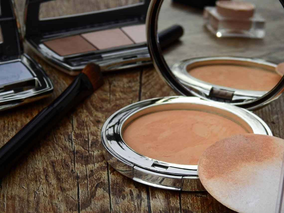 closeup of bronser/blush with a compact mirror