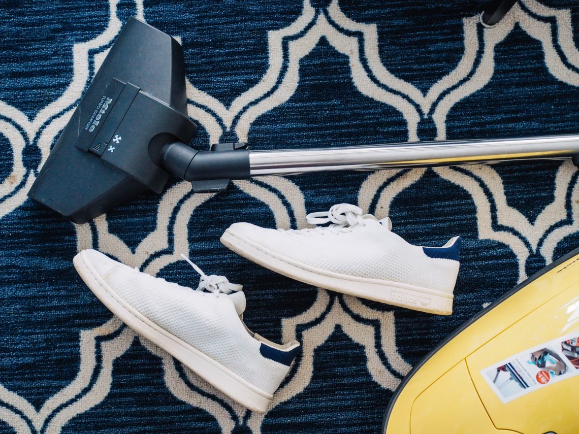 hoover and trainers on a patterned rug
