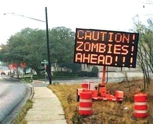 A hacked North Carolina dynamic message sign warning of zombies in the area. (Photo courtesy of www.securityforrealpeople.com)