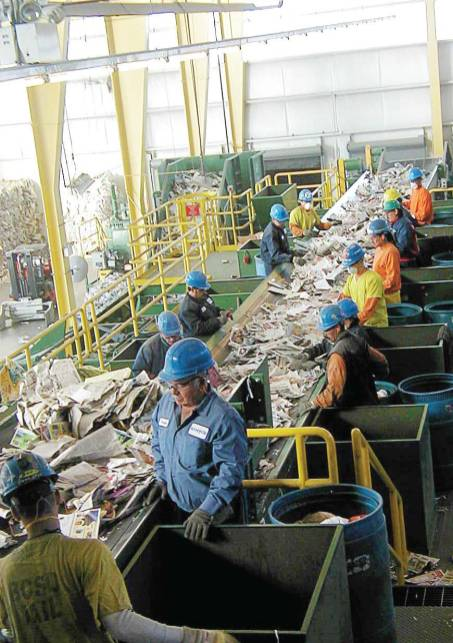 At Boulder County Recycling Center's paper sorting line, employees catch items that may hurt the machinery if they were to get through.