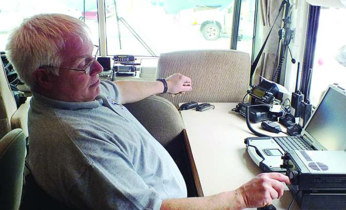 James Duram, K8COP, of the Muskegon County Emergency Communications Group, operates from a camper trailer during a Field Day weekend. Annual Field Day events held by the American Radio Relay League are meant to simulate how amateur radio communication should work during a disaster that takes out the permanently installed radio infrastructure. (Photo credit James Meyers, KC8PCJ)