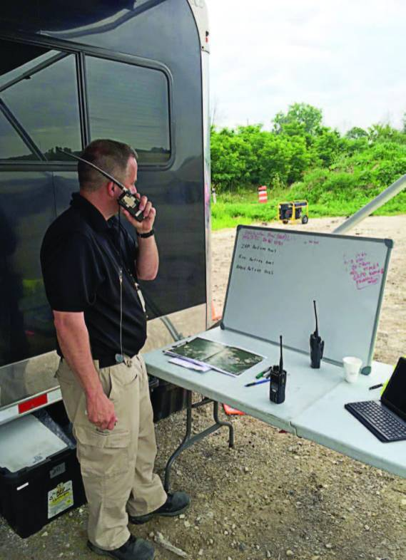 Kim Karr, K8KDK, operates from Muskegon County's Mobile Command during an ARRL winter Field Day in Muskegon, Mich. (Photo credit Tom Porritt, K8EOD)