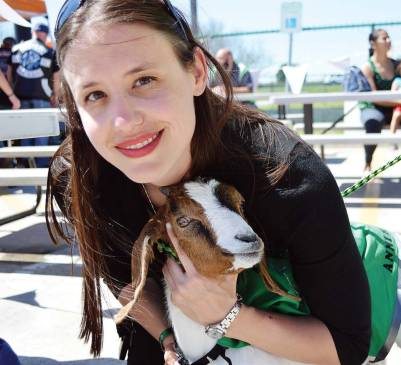 Campbell and Annie the goat promote tactics for coping with the stress and trauma of EMT work at a recent event.