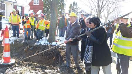 Getting the lead out of Flint is a number one priority for Mayor Karen Weaver, who has launched the Fast Start plan to remove 15,000 lead and galvanized steel service pipes. Pictured center and from left, are General Michael McDaniel, lead on the Fast Start plan; Mayor Virg Bernero of Lansing, Mich.; and Weaver, removing one of the lead-tainted pipes. (Photo provided by the city of Flint)
