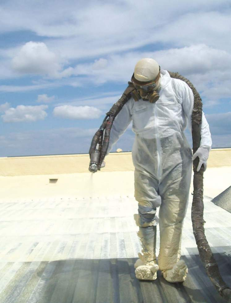 A worker applies spray polyurethane foam onto a metal deck roof. (Photo provided by SPFA)