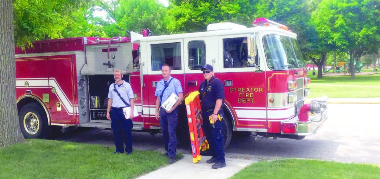 On selected weekends, members of the fire department are joined by citizen volunteers from the American Red Cross, service clubs, high school clubs and residents to canvas a target area by knocking on every door. (Photo provided)