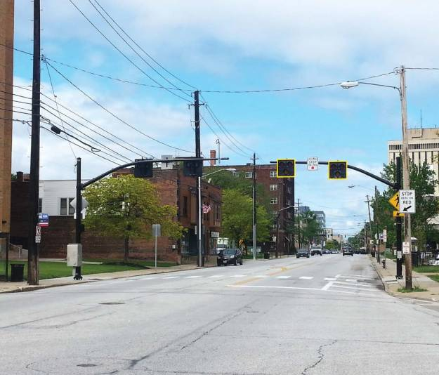 A HAWK system is designed to stop traffic only as needed when pedestrians are present at the crosswalk. Pictured is the signal at Manor Park and Detroit Avenues. The silver box on the left is the signal controller cabinet to operate the signal. (Photo provided by Lakewood, Ohio)