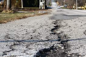 Budget crises and maintenance costs are driving some cities and counties to eye different approaches when it comes to crumbling roads, including reverting back to gravel. (Shutterstock.com)