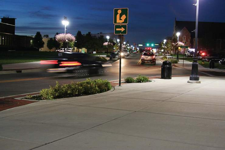 Vehicles travel through downtown Fenton as the city's new streetlights illuminate the area. (Photo provided)