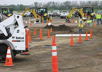 Pictured is West Des Moines' skid load roadeo, with the backhoe roadeo going on in the background. (Photo provided by West Des Moines, Iowa )