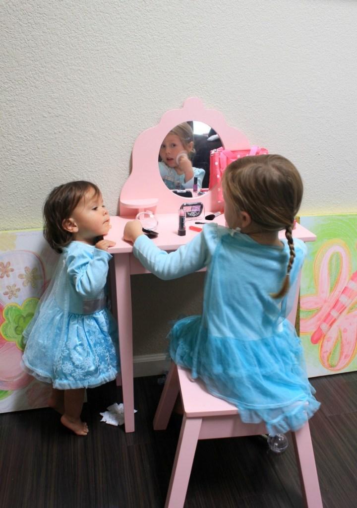 Little girls with pretend makeup