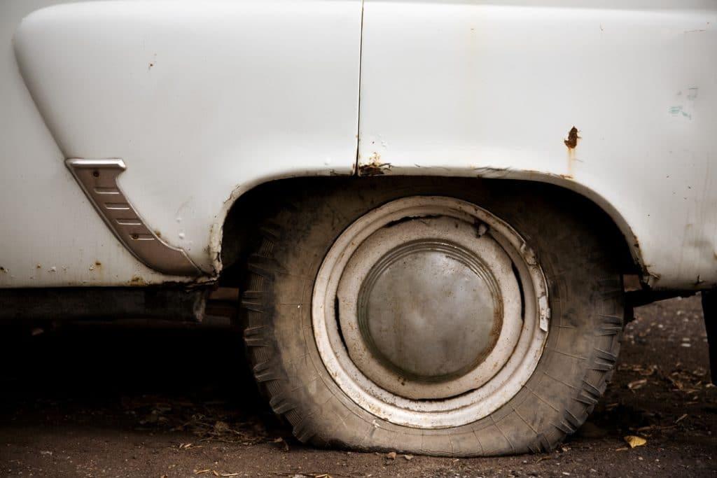 old car, flat tire
