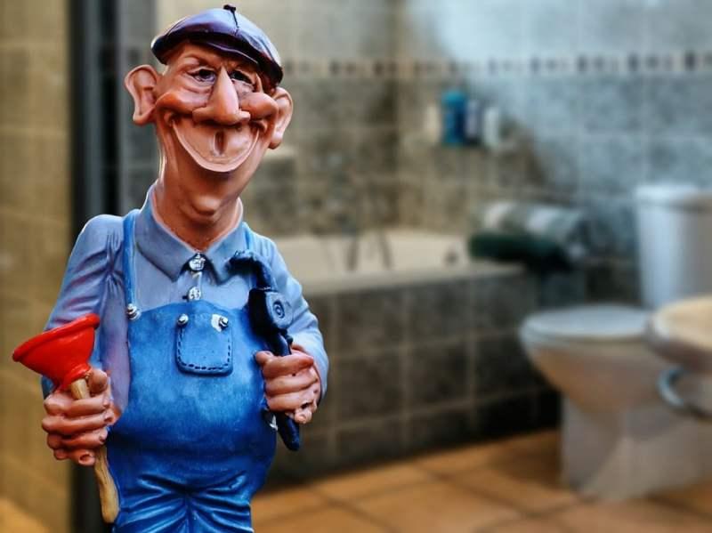 Toy plumber in bathroom