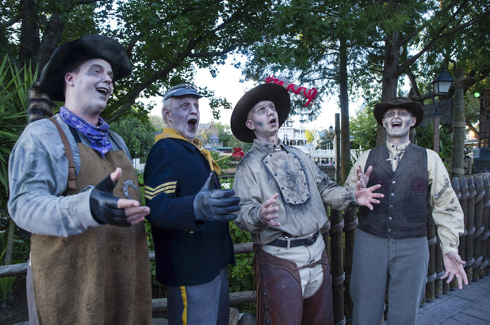 """The Cadaver Dans perform their ghoulish medley of popular """"tombs"""" for guests in Frontierland during Mickey's Not-So-Scary Halloween Party at the Magic Kingdom. The family-friendly after-hours event offers trick-or-treating, meet and greets with favorite characters in costume, plus the must-see """"Mickey's Boo-to-You Halloween Parade"""" and """"Happy HalloWishes"""" fireworks display. Mickey's Not-So-Scary Halloween Party is a special ticket event and takes place on select nights each fall at Walt Disney World Resort in Lake Buena Vista, Fla."""