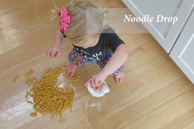10 indoor play ideas: noodle drop activity