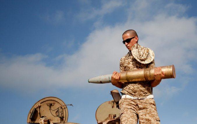 Libyan Soldier Loads Tank
