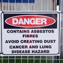 Asbestos fibers carried on machine worker caused wife's mesothelioma.