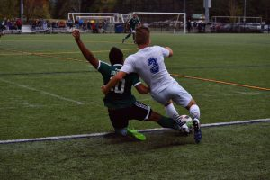 Mid fielder Colin Knight slides for the ball. Photo by Brody Jones.