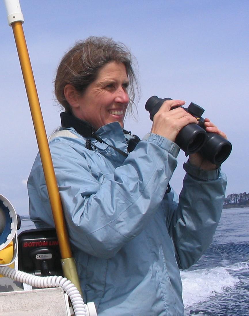 Jane Watson on boat with binoculars o