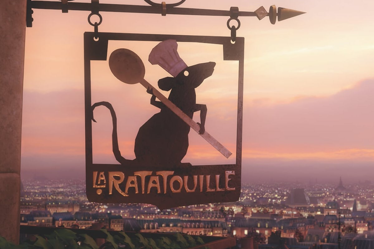 The photo is from an animated scene from Ratatouille. It shows a metal sign of a rat wearing a chefs hat holding a wooden spoon. The sign displays the name of the restaurant, La Ratatouille.