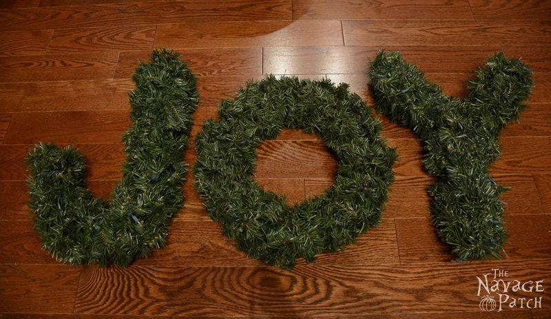 JOY Wreath (Inspired By Ballard Designs) | Ballard Designs knockoff decoration | How to make a monogram wreath | Lighted Christmas Wreath | DIY knockoff holiday decor | Upcycled Christmas decoration | #TheNavagePatch #DIY #Upcycled #Christmas #Christmascrafts #Holidays #Holidaydecor #DIYChristmas | TheNavagePatch.com