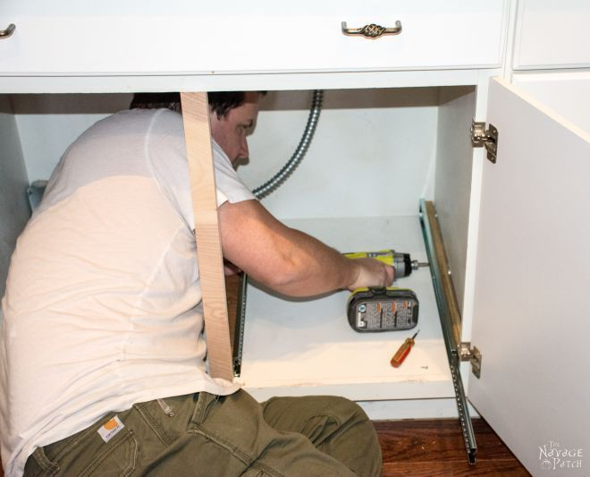 lumpy man squeezed into an empty cabinet