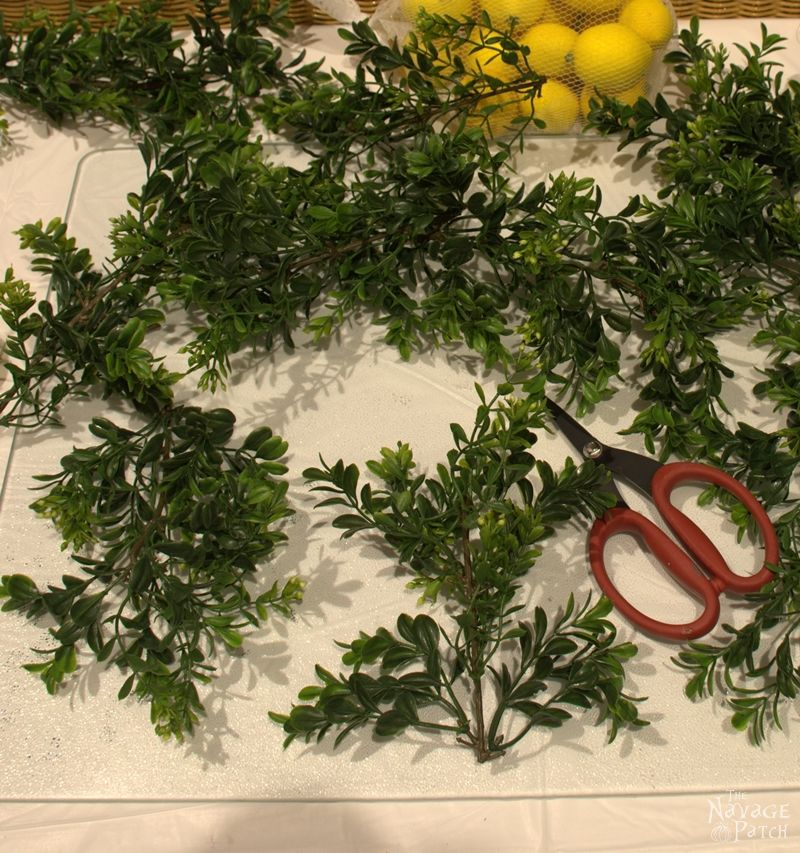 Faux greenery and a pair of scissors