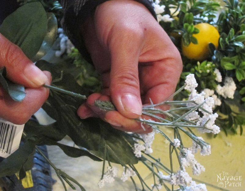 breaking off the stems of faux flowers